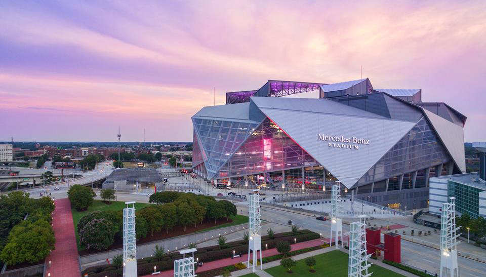 colorful sunset behind mercedes benz stadium
